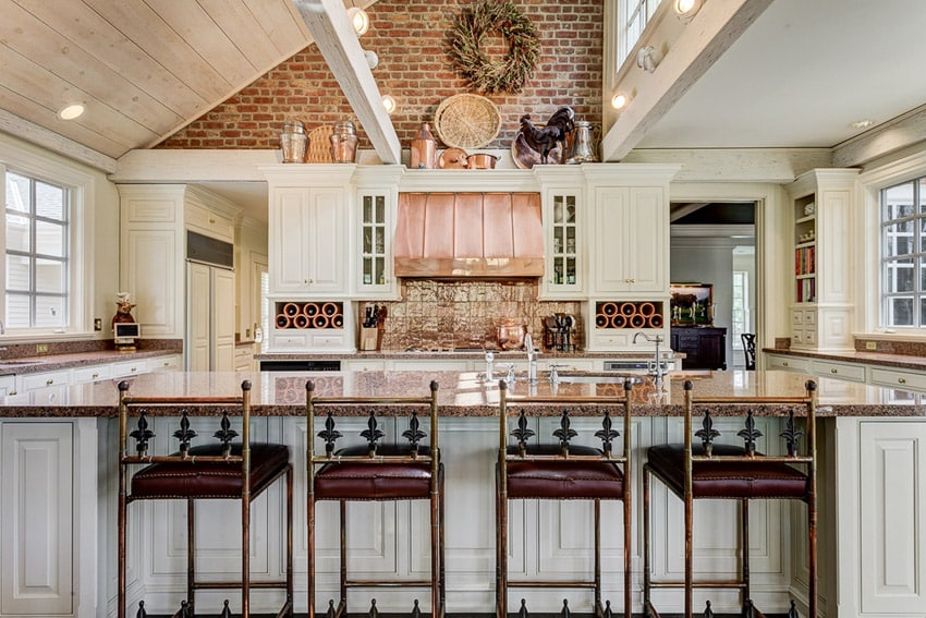 Country kitchen with santa barbara granite and white cabinetry