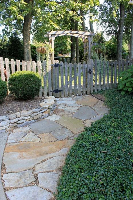 Gold quartzite walkway with gate arbor