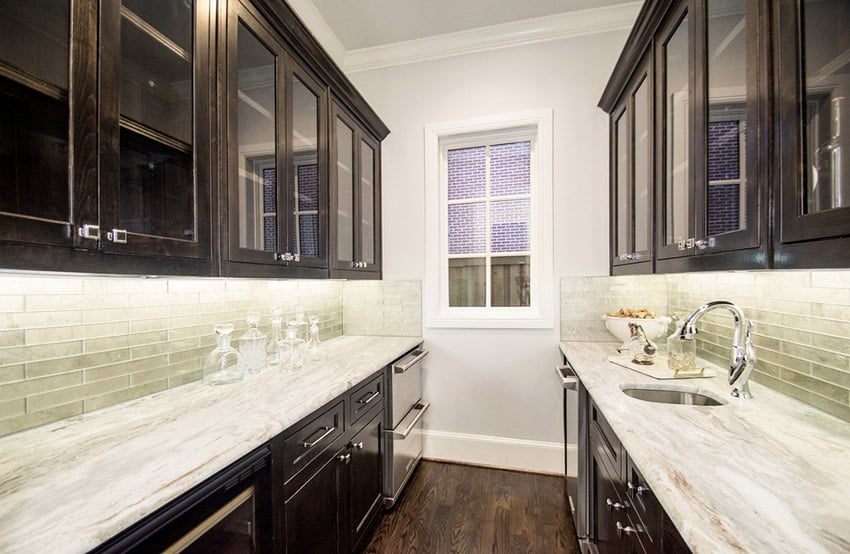 Small galley kitchen with sugar beige marble counters