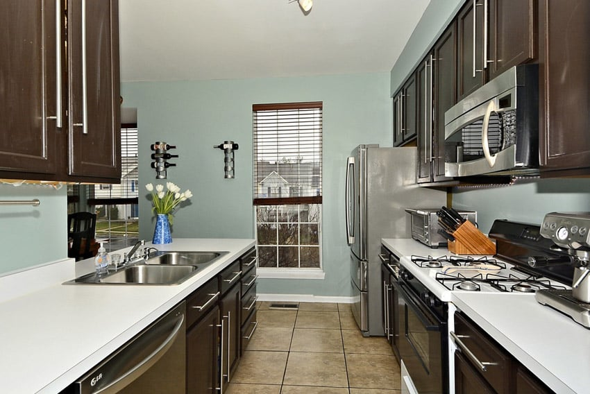 Small galley kitchen with white laminate counters