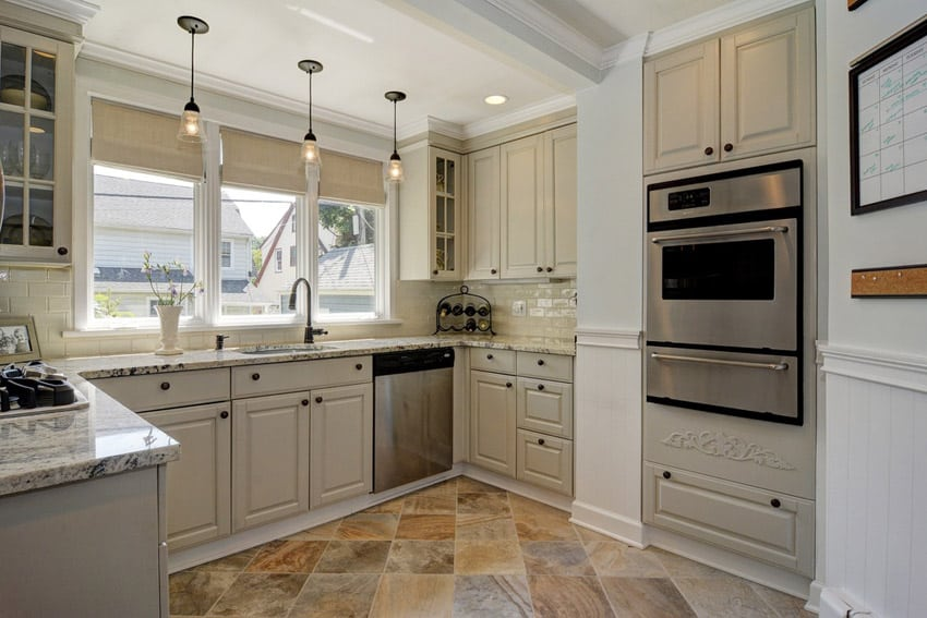 Small kitchen with calacatta vagli marble countertops and peninsula