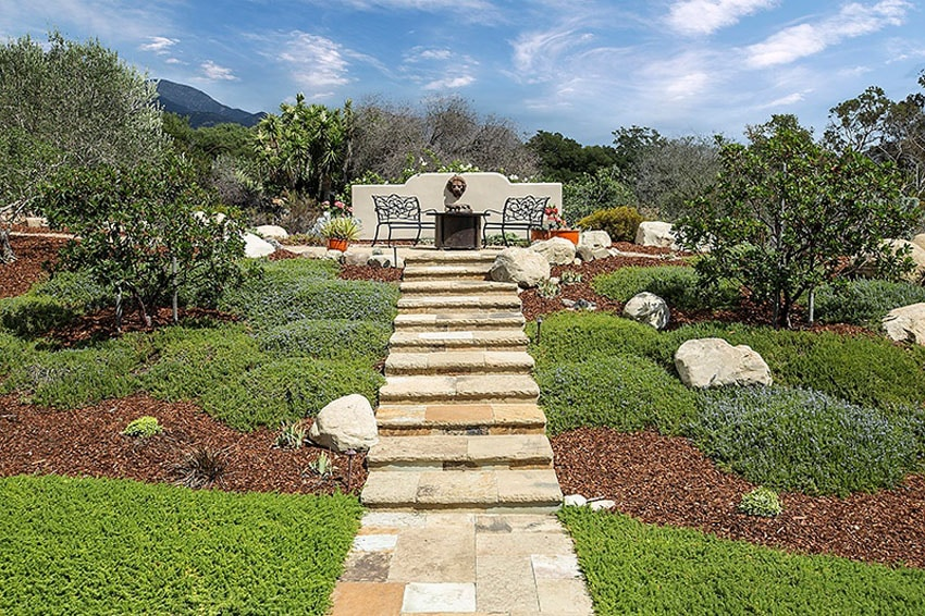 Stone tile floor walkway with steps to outdoor sitting area