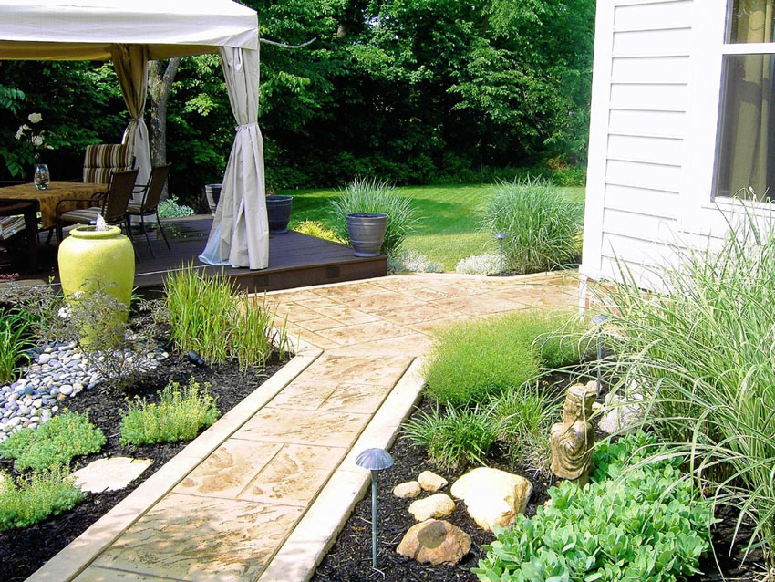 Stone tile steps to covered deck canopy seating area