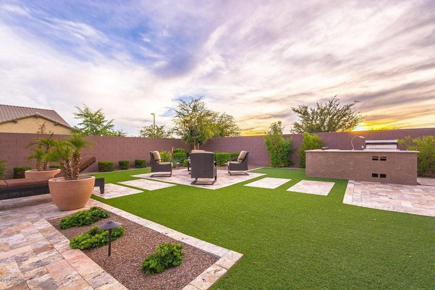 Travertine pavers walkway to outdoor kitchen and sitting area