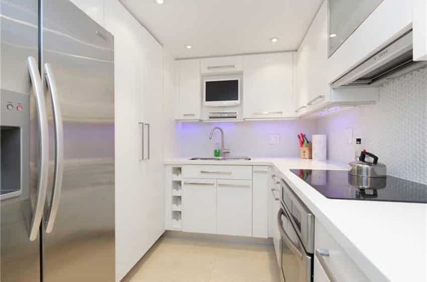 White closed kitchen layout with neon backlight