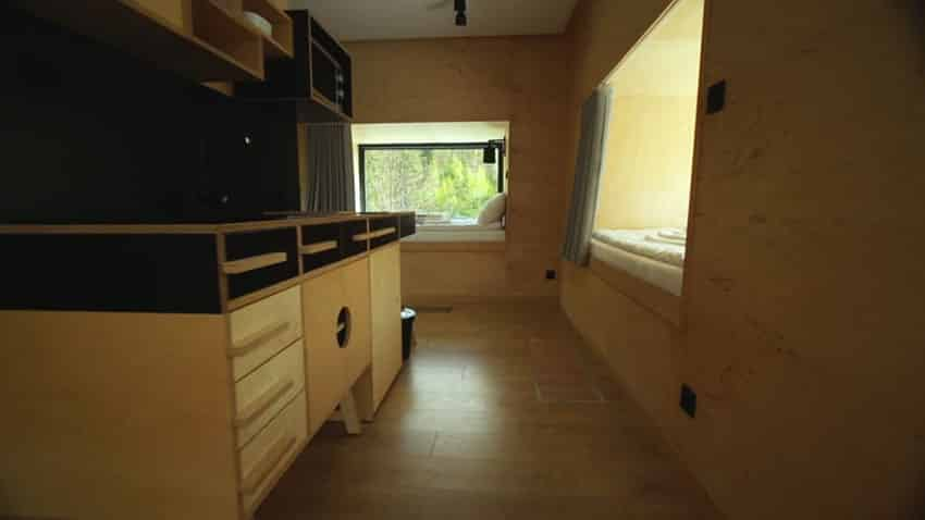 Micro apartment kitchen design with view to sleeping area
