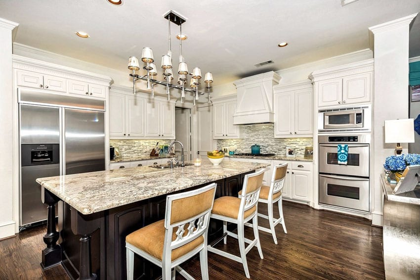 Kitchen with white cabinetry and white spring granite counters