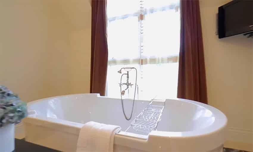 Large soaking bathtub in master suite