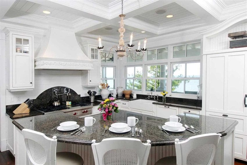 White country style kitchen with chandelier and curved dining island