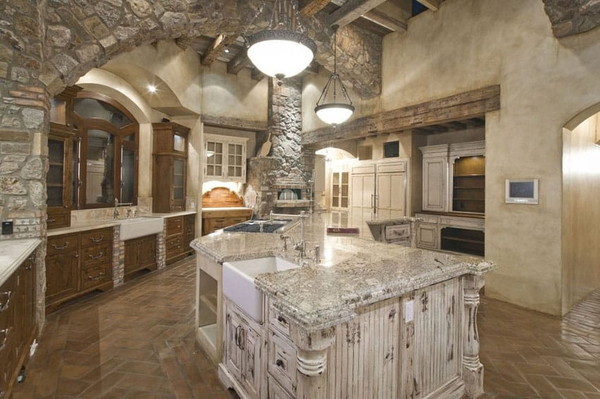 Beautiful stone kitchen with fireplace and curved island