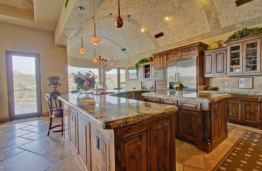 Gorgeous traditional kitchen with arched stone ceiling rustic cabinetry