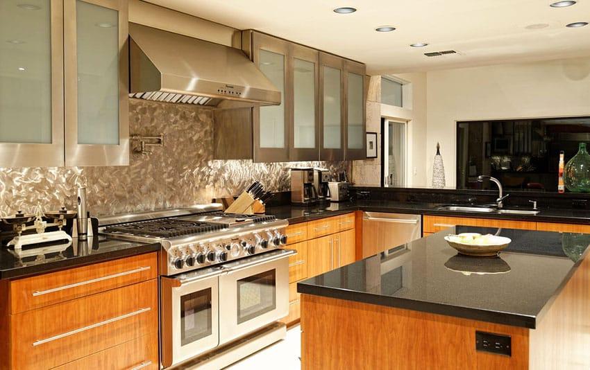 Kitchen with swirled stainless steel backsplash