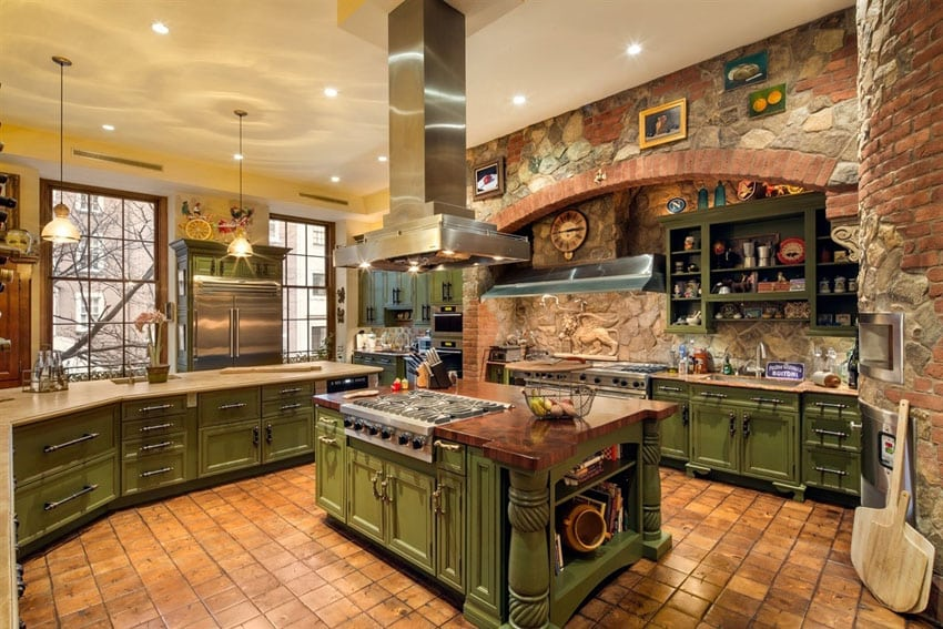 Mediterranean style kitchen with island with range and hood green cabinetry
