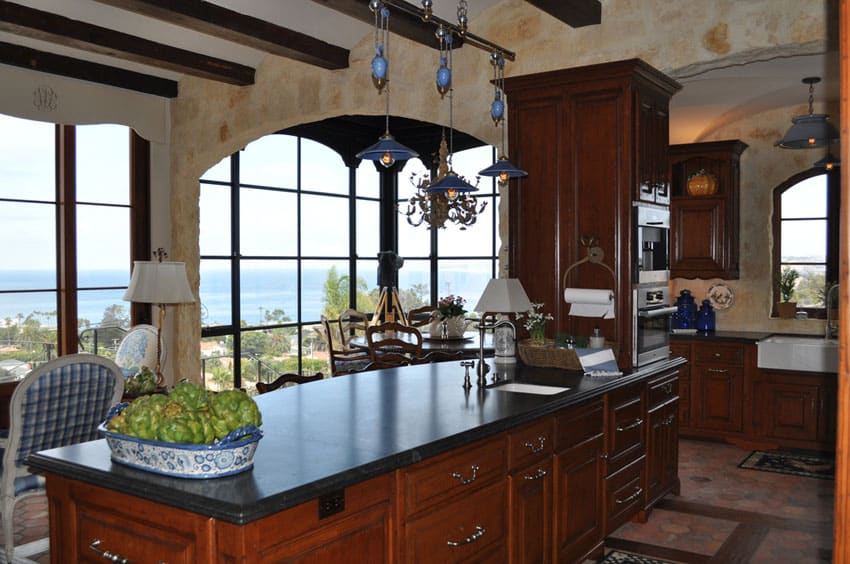 Traditional rustic kitchen with limestone counter, exposed beams and oceanview