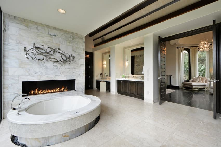 Amazing master bathroom suite with oval bathtub and fireplace