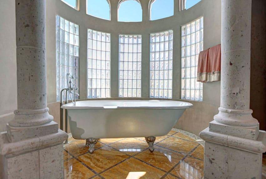 Cast iron clawfoot tub in luxury bathroom with pillars