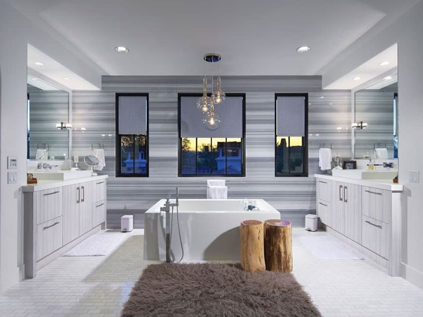 Contemporary bathroom with freestanding tub and bubble pendant lights