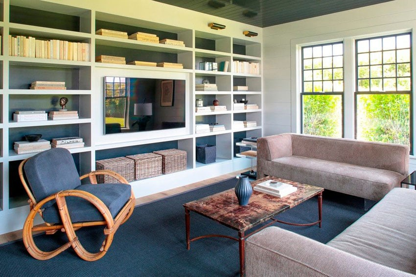 Contemporary living room with built in bookshelves