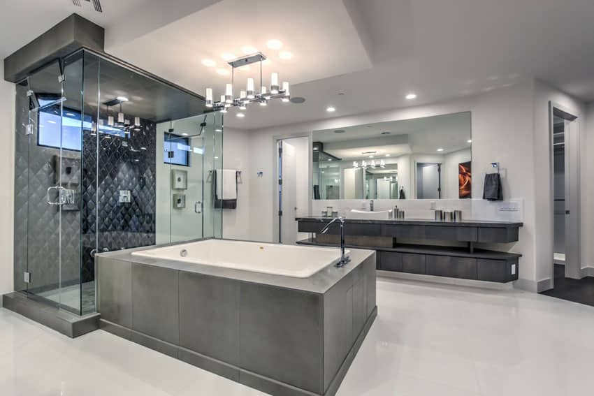 Contemporary master bathroom with dark tile