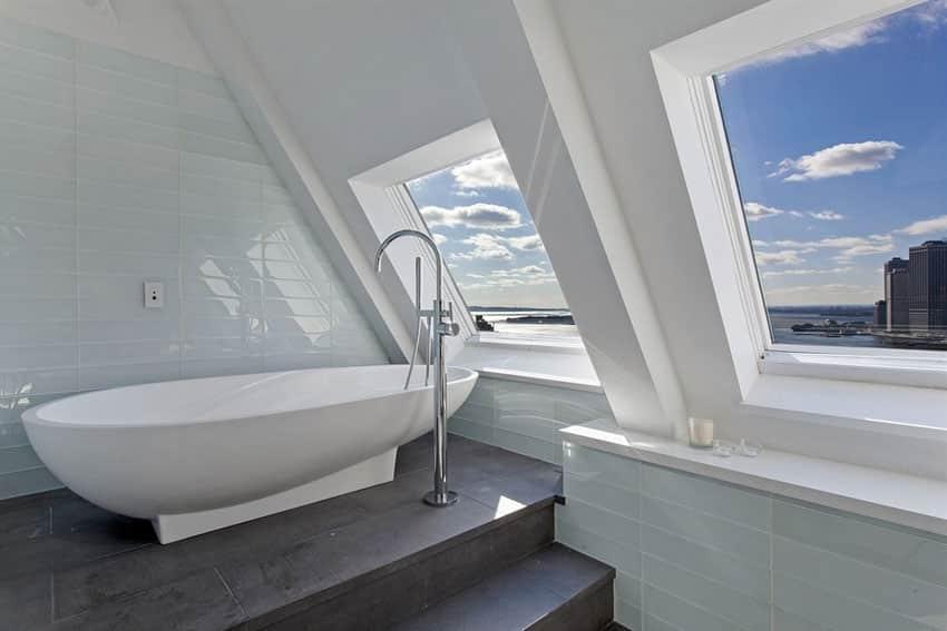 Contemporary master bathroom with pedestal bathtub and high city views