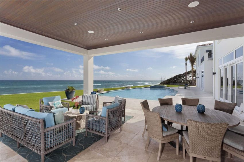 Contemporary ocean view patio next to swimming pool