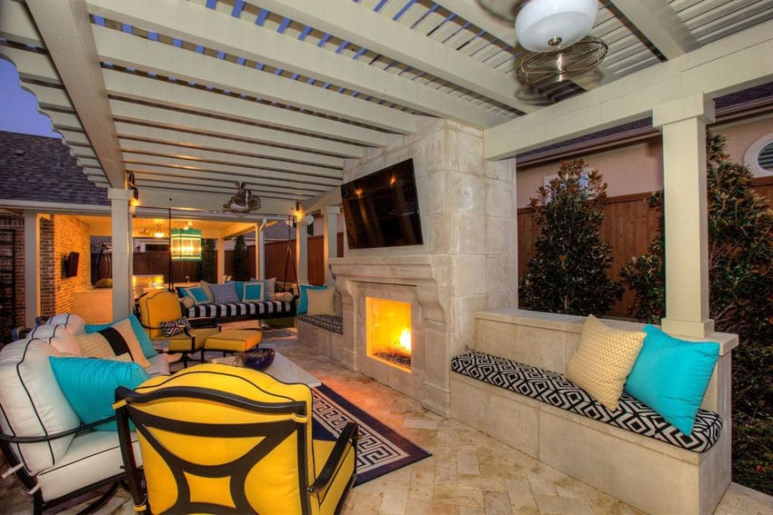 Contemporary patio with pergola bench sitting area and fireplace