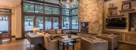 contemporary-stone-and-wood-living-room-with-fireplace-and-beautiful-views-of-the-outdoors