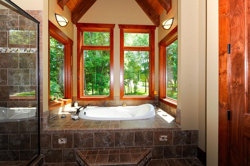 Craftsman master bath with elevated bathtub with outdoor views