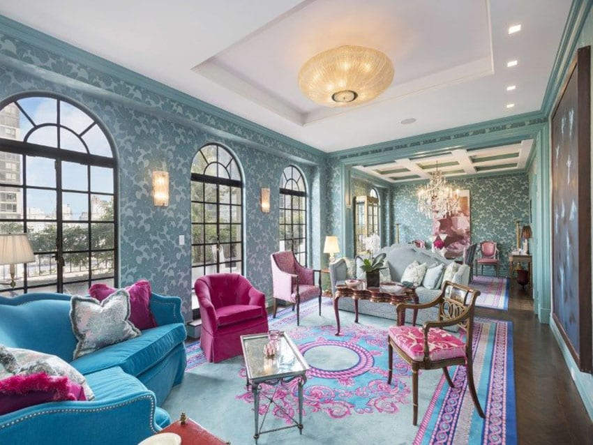 Eclectic living room with blue patterned wallpaper