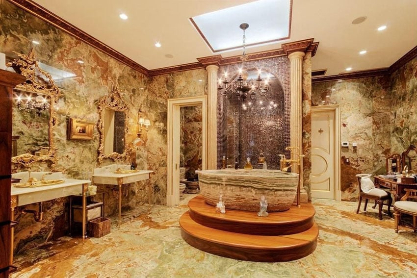 Luxury bathroom with natural stone bathtub quartz floor tiles and granite walls