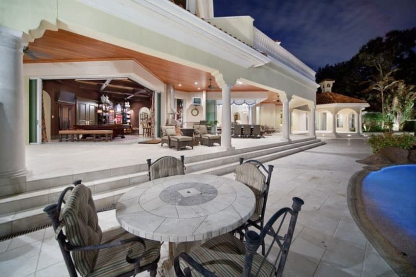 Luxury entertaining patio with retractable doors to living room