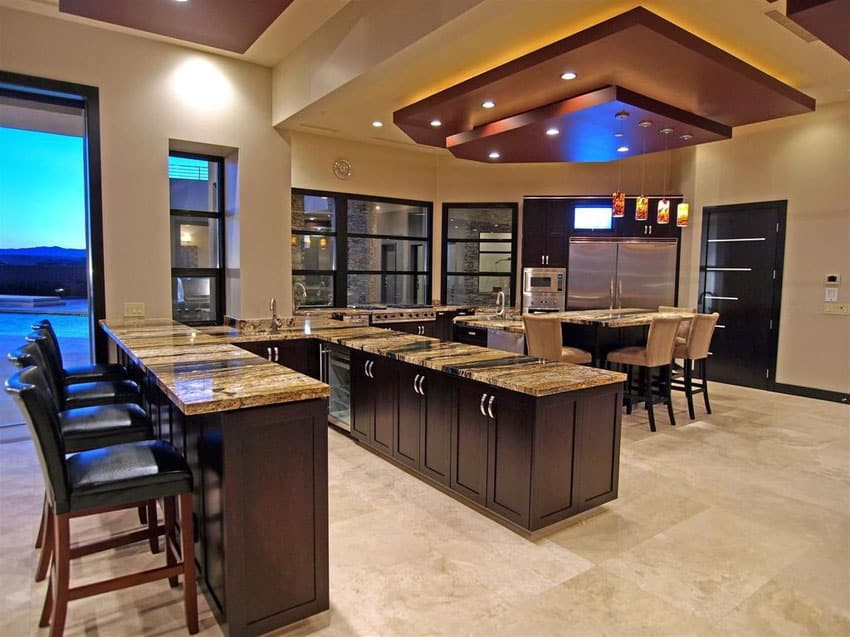 luxury kitchen with breakfast bar peninsula and travertine flooring - Lighting Bars For Kitchens