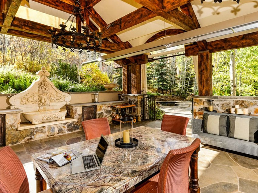 Luxury patio with fountain, granite table and rustic chandelier