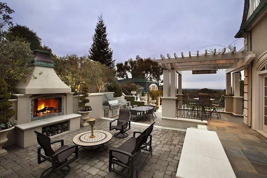 Luxury paver patio with outdoor fireplace and pergola