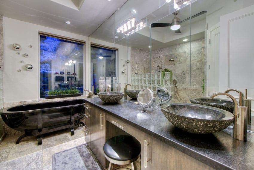 Master bathroom with black acrylic bathtub on stand
