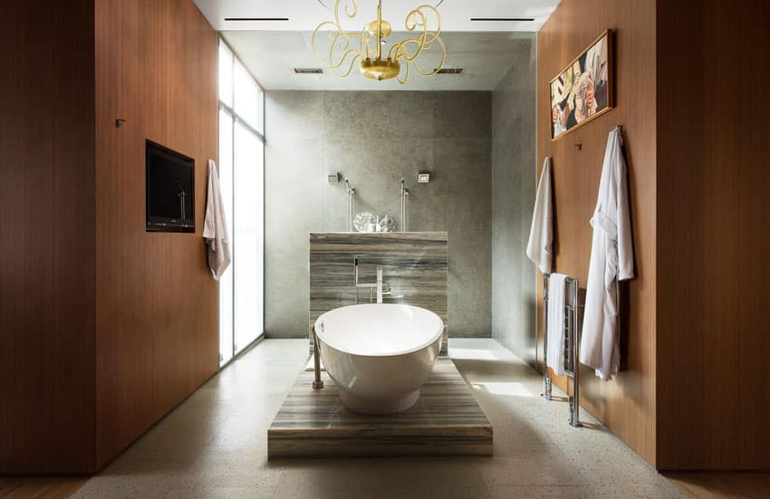 Master bathroom with pedestal bathtub and contemporary design style