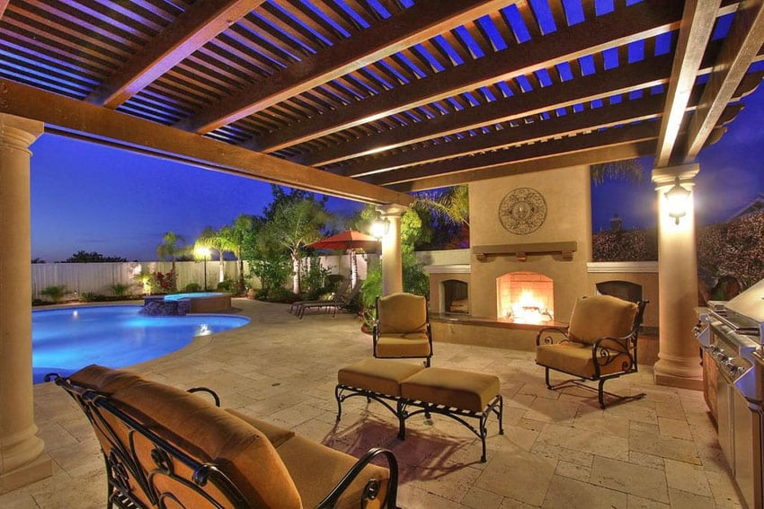Mediterranean style patio with travertine flooring, fireplace and swimming pool views