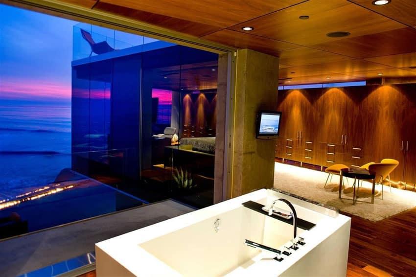 Modern bathroom with ocean view from acrylic bathtub