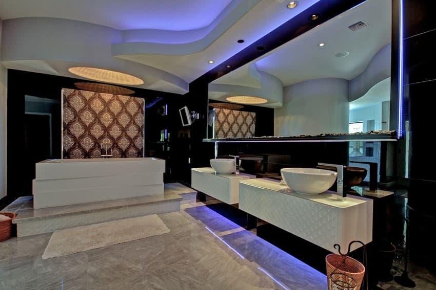 Modern bathroom with quartz floors, neon mirror and vanity lighting