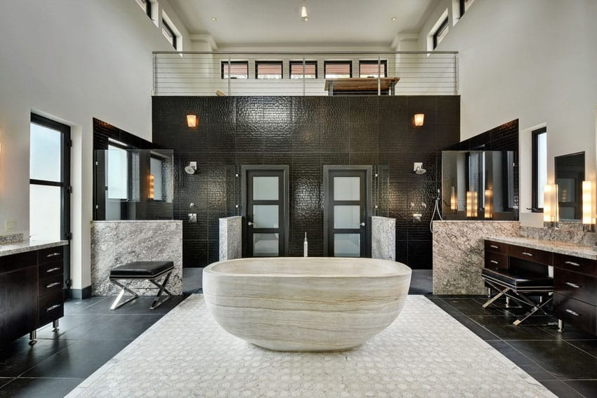 Modern bathroom with custom sandstone bathtub and dual marble vanities