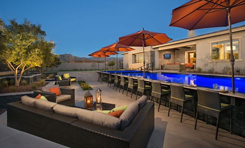 Modern patio with bar facing swimming pool