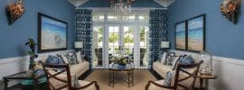 nautical-blue-themed-living-room-with-white-wainscoting-and-vaulted-ceiling