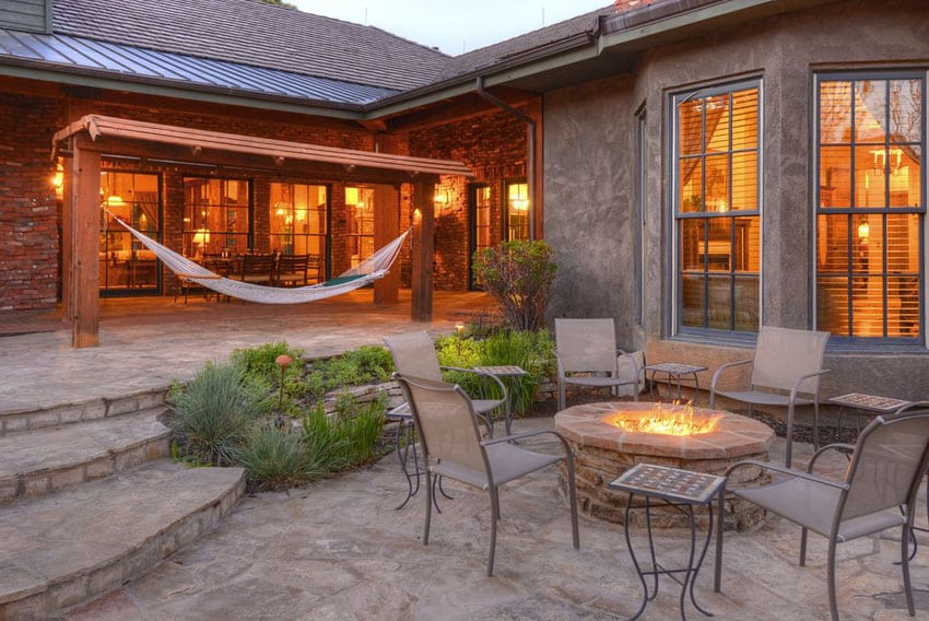 Patio with fire pit and wood canopy with hammock