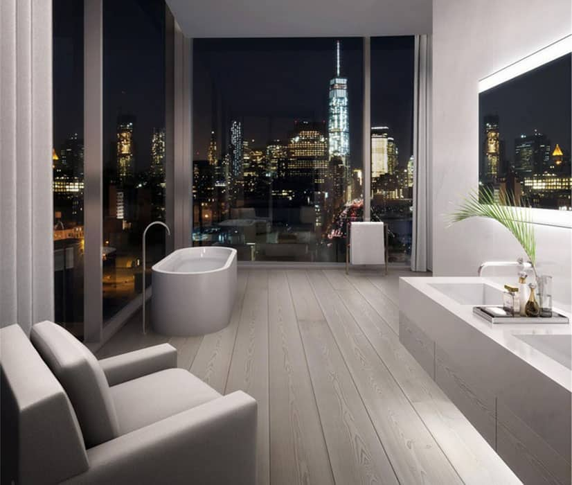 Penthouse apartment bathroom with city views from bathtub