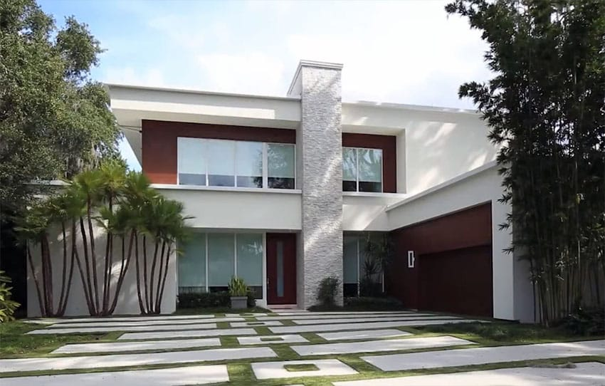 Custom 2 story modern house design with concrete and grass driveway