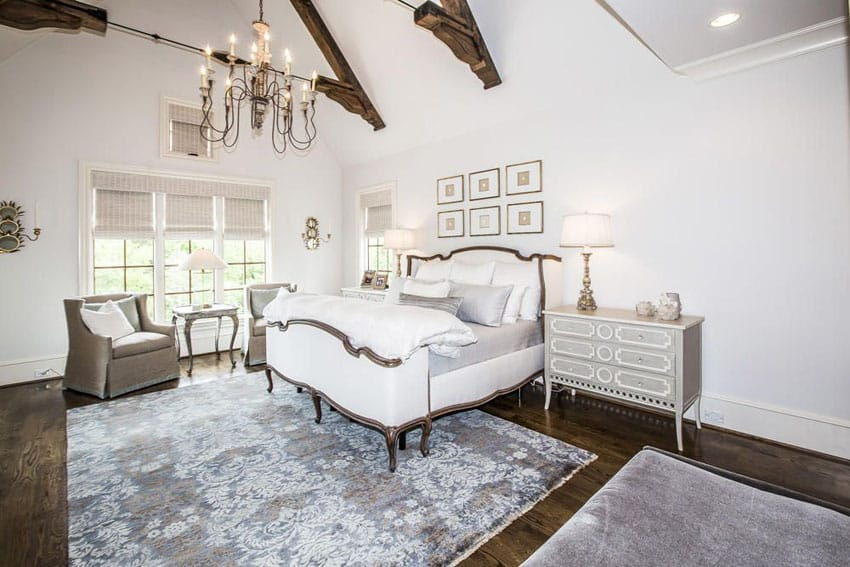 Beautiful bedroom with vaulted ceilings and Victorian style bed and furniture
