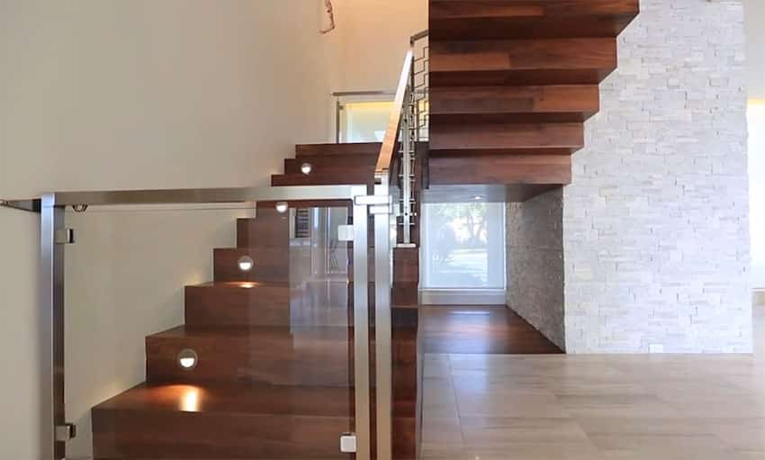 Beautiful wood staircase leading to second story of modern home