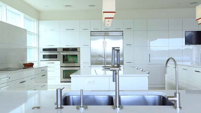 Close up view of white modern kitchen with eat in dining breakfast bar