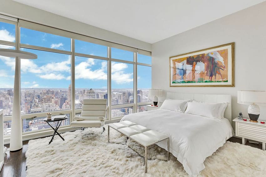 Contemporary bedroom with city views, shag carpet and white decor