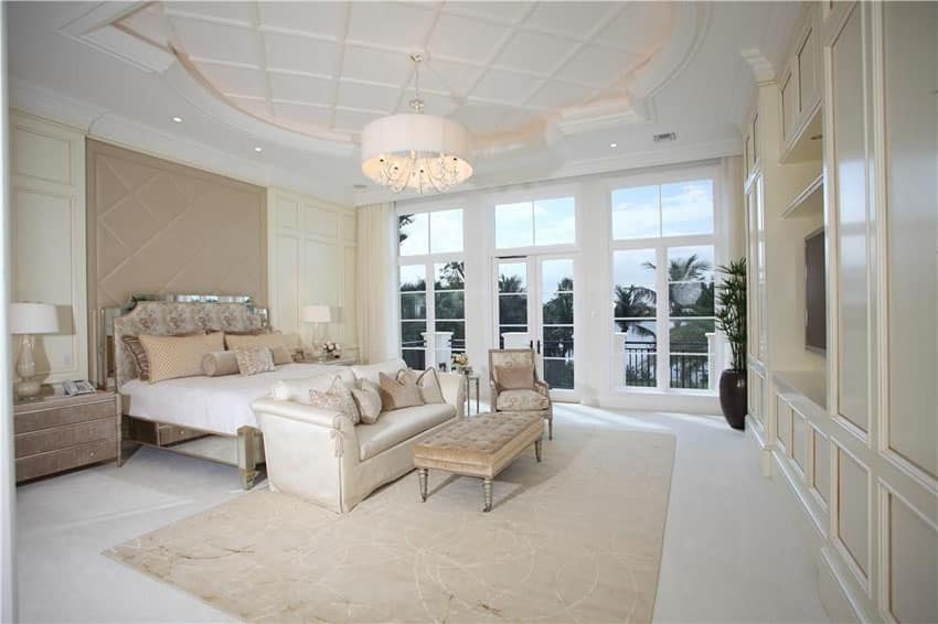 Contemporary bedroom with luxury finishes and balcony views